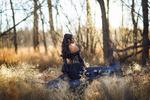 Обои Девушка в черном платье стоит в сухой траве, фотограф Irene Rudnyk