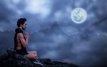Обои Мужчина медитирует, сидя на камне на фоне гор и полной луны ночью