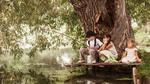 Обои Две девочки и мальчик сидят на деревянных мостках на берегу пруда с удочкой
