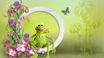 Обои Зеленая лягушка Маппет Керми сидит в цветах водосбора, рядом летает бабочка, автор коллажа MaDonna