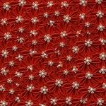 Обои Фон состоящий из множества красных цветов из лент с украшением в сердцевине