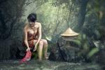 Обои Девушка, после купания, сидит на камне и полоскает одежду, by Sasin Tipchai