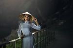 Обои Азиатка в национальной одежде стоит у перил в горах, by Sasin Tipchai