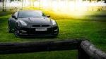 Обои Черный матовый Nissan GT-R на траве