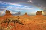 Обои Гепард лежит на ветке дерева на фоне пустыни, гор и радуги в облачном небе