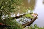 Обои Полузатопленная лодка у берега реки поросшая кустами, by Myriam
