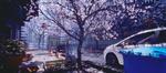 Обои Белый автомобиль на весенней улице города