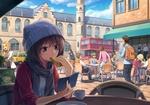 Обои Девочка в шапочке сидит за столиком кафе на улице большого города, читая книгу и кушая бублик