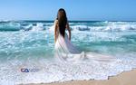 Обои Девушка в белом платье стоит в воде, любуясь морем, by Carlos Atelier2