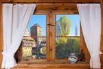 Обои Окно с занавесками, ваза на подоконнике, за стеклом вид на старый город, by Gerhard Gellinger