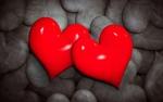 Обои Два красных сердца на фоне множества серых сердец