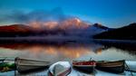 Обои Лодки на озере и вдалеке гора под облаками