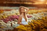 Обои Девушка-блондинка стоит среди цветов, by Mauro Lainetti