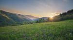 Обои Закат солнца на фоне горного луга