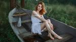 Обои Модель Наташа сидит в лодке. Фотограф Andrey Metelkov