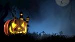 Обои Светильник Джека лежит на траве на фоне дома в ночь на Хеллоуин / Halloween