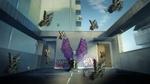 Обои Парень сидит на крыше здания, прислонившись к стене, на котором графити, летают бабочки