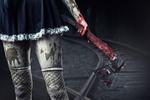 Обои Перепачканная в грязи девушка в чулках с окровавленным топором в руке идет по железнодорожным путям