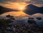 Обои Закат солнца над водоемом. Фотограф Dag Ole Nordhaug