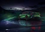 Обои Зеленый BMW Concept M8 Gran Coupe стоит на льду на фоне гор под пасмурным небом