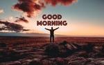 Обои Мужчина стоит на камнях, подняв и расправив руки (good morning / доброе утро)