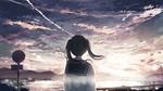Обои Девушка стоит на фоне облачного неба
