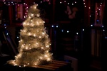 Обои Новогодняя елка на темном фоне с огоньками гирлянд, by Nina Stojanovic