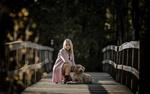 Обои Девушка с собакой сидят на мосту