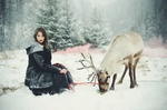 Обои Девушка на снегу рядом с оленем