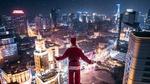 Обои Санта Клаус стоит на фоне ночного города