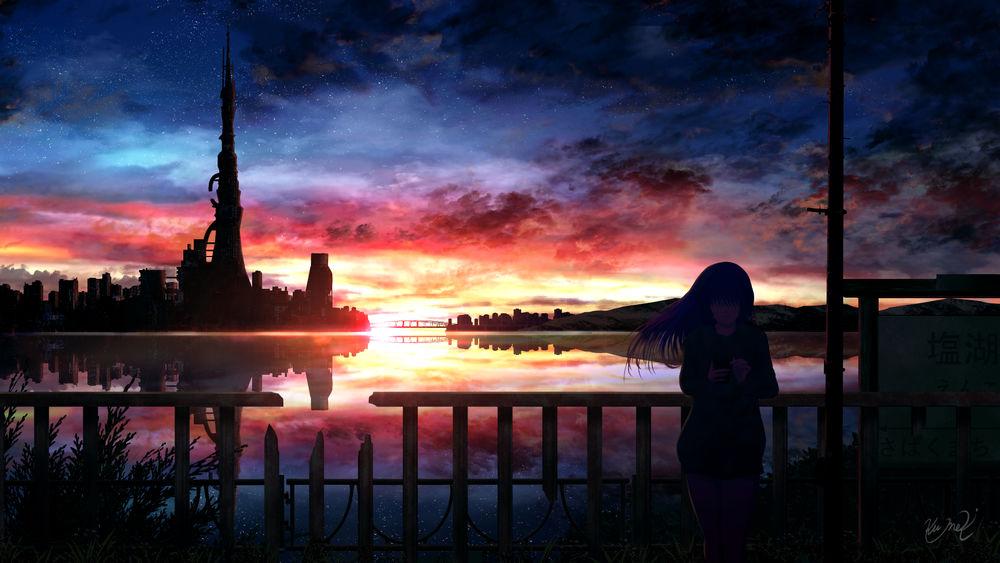 Обои для рабочего стола Девушка с телефоном в руке стоит возле забора на берегу реки, по ту сторону которой город