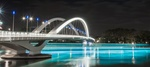 Обои Красиво подсвеченный ночью мост через реку, by Ludovic Charlet