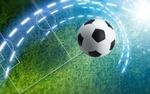 Обои Летящий над полем по траектории футбольный мяч
