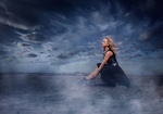 Обои Модель Оксана сидит на фоне облачного неба, by Arif AtlД±