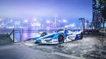 Обои Болид BMW i Andretti Motorsport, участник чемпионата ABB FIA Formula E 2018 / 19, стоит на пирсе, с видом на утренний Hong-Kong, China / Гон-Конг, Китай