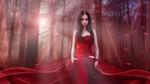 Обои Девушка в красном платье стоит на фоне деревьев