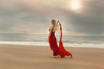 Обои Девушка в красном платье идет по побережью, by Anne Costello