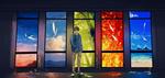 Обои Парень стоит на фоне треснувших стекол, на которых нарисован закат, рассвет, море, осень и весна