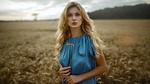 Обои Девушка Карла в голубом платье стоит на фоне поля, by Damian Piоrko