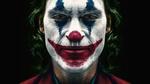 Обои Американский актер Joaquin Phoenix / Хоакин Феникс в роли Joker / Джокера из одноименного фильма 2019 года