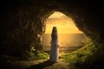 Обои Девушка в белом платье стоит у выхода из пещеры и смотрит на птиц, летящих в свете морского заката, by Stine86Engel