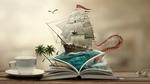 Обои Парусник в океане среди акул, пальм и щупальцы гигантского осьминога в книге, которая лежит рядом с чашкой на блюдце и наушниками, by Ferdi Rizkiyanto