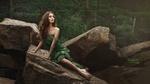 Обои Длинноволосая девушка Таня в платье с открытыми плечами сидит на камне на фоне леса, by Ivan Kopchenov
