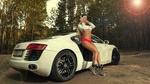 Обои Модель Марина Васильева в наушниках, в топе и в трусиках стоит у авто на лесной дороге