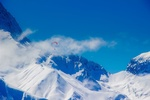 Обои Парашют на фоне неба и заснеженных гор. by 12019