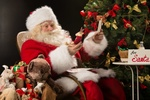 Обои Санта Клаус сидит в кресле -качалке возле елки и читает письма (for Santa)