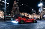 Обои Красный Chevrolet Corvette C8 в вечернем городе на Рождество, by Sergey Poltavskiy