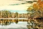 Обои Озеро на фоне лодки с людьми, домика на берегу, осенних деревьев и неба с облаками, by David Mark