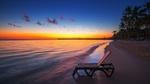 Обои Шезлонг на пустом тропическом пляже с пальмами на рассвете, by Valentin Valkov