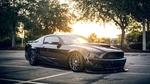 Обои Черный Ford Mustang освещенный солнечными лучами, by Lance Asper